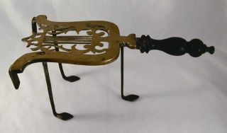 Antique Brass & Cast Iron Trivet Lyre Form Iron Legs And Turned Wood Handle photo