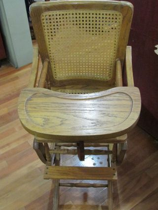 Antique Oak Wood And Wicker Baby High Chair Folds Down To Childs Rocker photo
