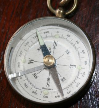 Vintage German Brass Compass With Leather Buttonhole Strap. photo