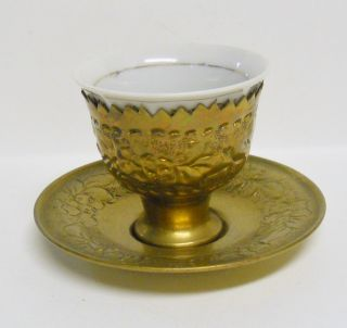 Antique Brass Cup Holder And Saucer And Porcelain Cup photo