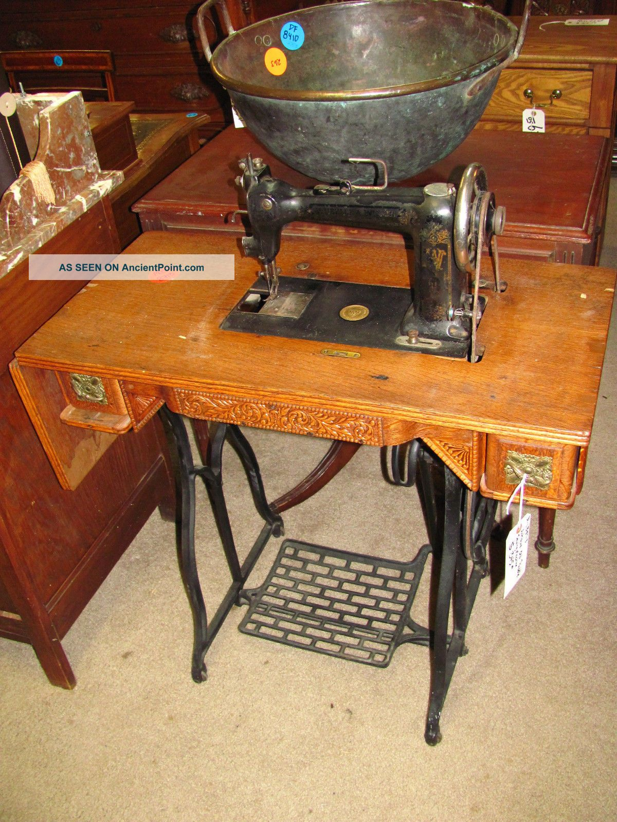 Antique Peddle Sewing Machine With Oak Table Sewing Machines photo
