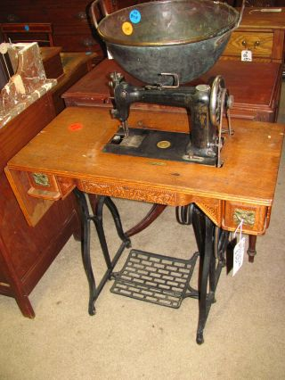 Antique Peddle Sewing Machine With Oak Table photo