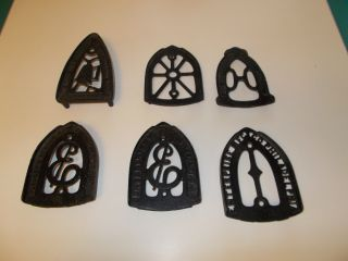 Of 6 Antique Sad Iron Cast Iron Trivets photo
