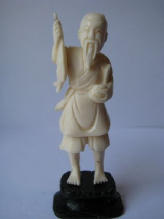 Old Chinese Carved In Deer Bone,  Fisherman photo