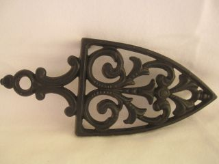 Antique/vintage Griswold 4 Cast Iron Trivet 1725 8.  75