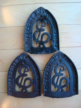 3 Antique Sad Iron Trivets Enterprise Mfg Co.  Philadelphia Usa,  Phila.  Cast Iron photo