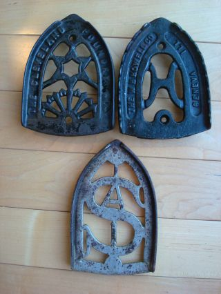 3 Antique Sad Iron Trivets Sunburst Star,  Letter H,  S A,  Geneva Ill,  Cleveland O photo