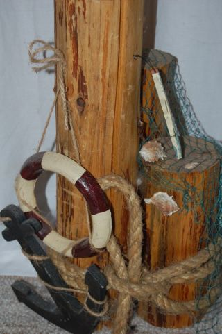Nautical Pylons Pier Nets Fish Shells Crabs Anchor Life Vest Preserver Rope Hook photo