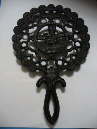 Pennsylvania Dutch Jzh Cast Iron Tulip Girl Trivet _ Union Mfg.  Co photo