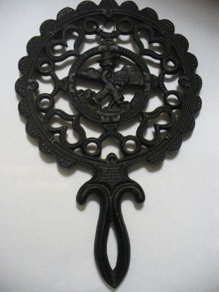 Pennsylvania Dutch Jzh Cast Iron Tulip Boy Trivet _ Union Mfg.  Co photo