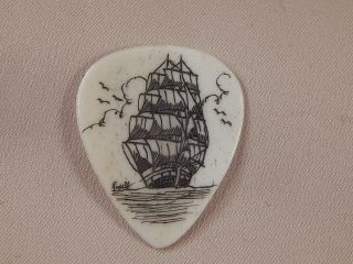 Scrimshaw Bone Guitar Pick - Ship photo