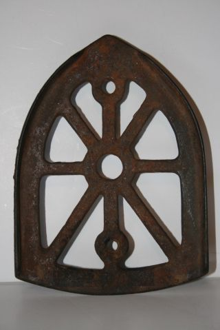 Antique Vintage Cast Iron Trivet Sad Iron Trivet photo