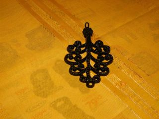 Small Cast Iron Wall Hanging Trivet,  Leather Hang Strap. photo