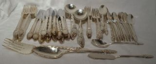 International Silver First Love 70 - Piece Set For 12 photo