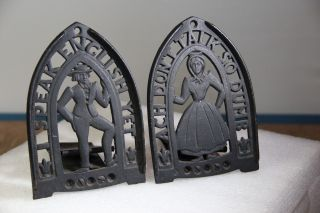 Vintage Sad Iron Trivets Or Bookends - Unusual Man & Woman Pair photo