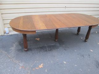 54679 Antique Round Oak Dining Table With 6 Leafs photo