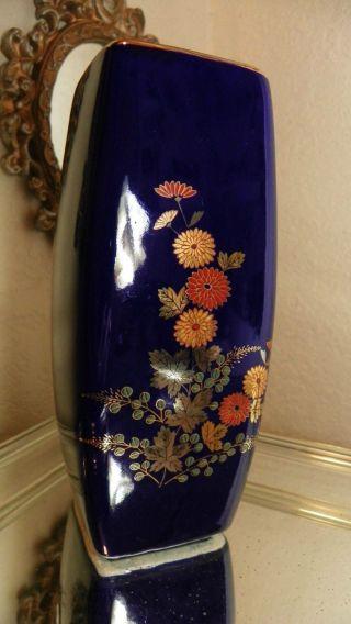 Cobalt Blue Porcelain Vase W/ Oriental Motif With Gold Flowers & Trim photo