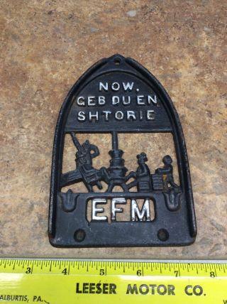 Vintage Cast Iron Efm Trivet Now Geb Du En Shtorie photo