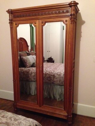 Renaissance Revival Carved Walnut Mirrored Armoire photo