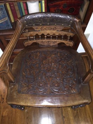 Antique Hand Tooled Leather Chair photo