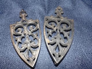 Of 2 Antique Cast Iron Marked Jmc Kitchen Table Or Sad Iron Trivet Trivets photo