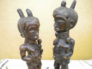 African Luhya Tribe From Kenya Happy And Prosperity Wood Carvings photo