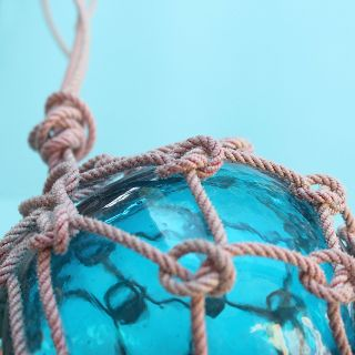 Vintage Beach Decor Blue Glass Fishing Float In Rope Netting photo