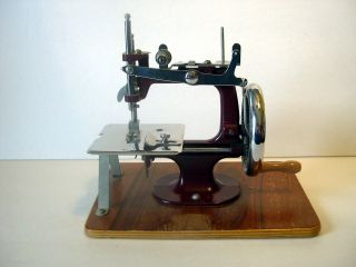 Vintage Essex Miniature Toy Sewing Machine Maroon England photo