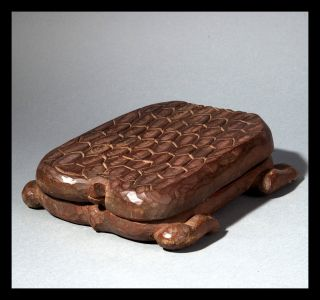 A Turtle Shaped Mancala Board From Ashanti People Of Ghana photo