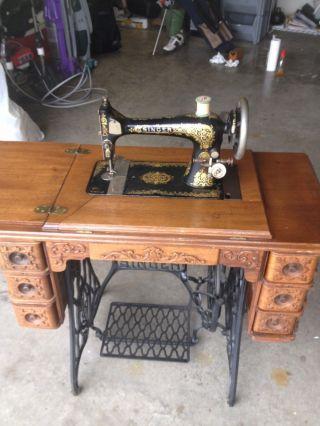 Antique Singer Sewing Machine Wooden Cabinet & Cast Iron Base photo