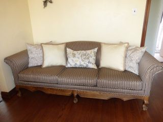 Wooden Claw Foot Shallow Queen Anne Camel Back Pinstriped Couch photo