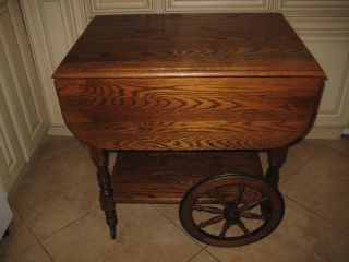 Antique Oak Drop Leaf Tea Cart Including Serving Tray photo