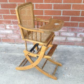 Antique Child ' S Oak High Chair Folds To Rocker Cane Seat & Back photo