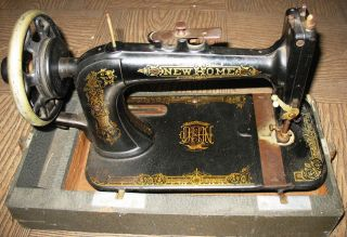 Antique Home Light Running Portable Sewing Machine photo