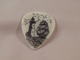 Scrimshaw Bovine Bone Guitar Pick - Ship - Lighthouse photo