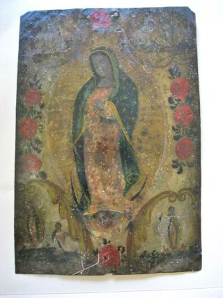 Antique Retablo On Tin With The Image Of Our Lady Of Guadalupe photo