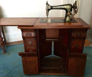 Antique 1909 Singer Sewing Machine In Oak Parlor Cabinet photo