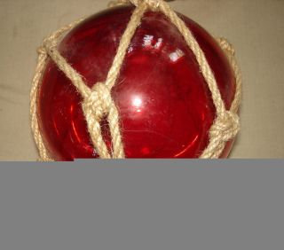 Blown Glass Red Nautical Fishing Float With Rope Netting photo
