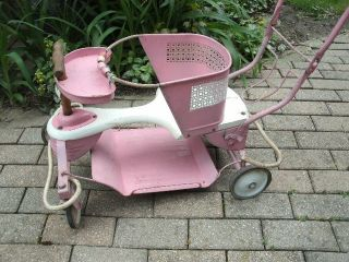Vintage Baby Stroller In Pink.  Taylor Tot Brand photo