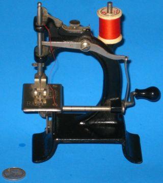 Victorian Baby Antique Sewing Machine Tiny Cast Metal Rare 1895 Crank A, photo