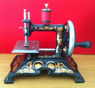 Antique Cast Iron Toy Sewing Machine - F.  Muller - Model 15 photo