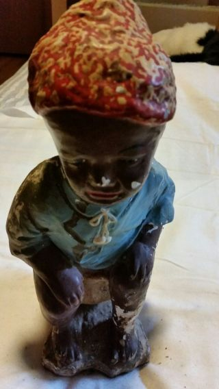 Vintage Statue Of A Black Boy Sitting On A Pot photo