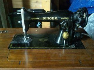 Vintage Singer Sewing Machine 1952 In Cabinet photo