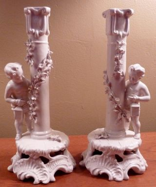 2 Sculptural White Bud Vases With Cherubs Or Putti,  Floral Garlands photo