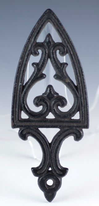Vintage Reverse Cathedral Mini Trivet 3 Feet Cast Iron 5.  5 Inch Spade Shaped photo
