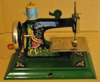Antique Toy Sewing Machine - Schuerhoff Gold Rain - Rare photo
