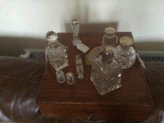 Lovely Selection Of Glass Perfume Bottles Etc With Silver Collars Or Lids photo