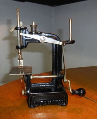 Vintage Smith & Egge Automatic Miniature Toy Cast Iron Hand Sewing Machine - 1897 photo