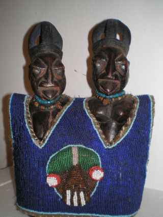 Yoruba Ibeji Figures With Beaded Jacket photo