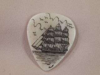 Scrimshaw Bovine Bone Guitar Pick - Side Ship photo